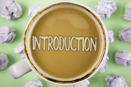 Handwriting text Introduction. Concept meaning First part of a document Formal presentation to an audience written Tea in White Cup within Crumpled Paper Balls plain Green background. Stockfoto