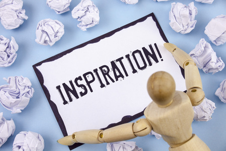 Handwriting text writing Inspiration Motivational Call. Concept meaning Stimulation to feel or do something creative written Sticky note paper within Paper Balls Plain background Wooden Toy