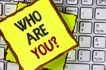 Text sign showing Who Are You Question. Conceptual photo Introduce or Identify Yourself Tell your Personal Story written Sticky Note Paper placed the Laptop.