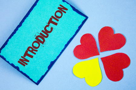 Text sign showing Introduction. Conceptual photo First part of a document Formal presentation to an audience written Sticky Note paper plain background Paper Love Hearts next to it.
