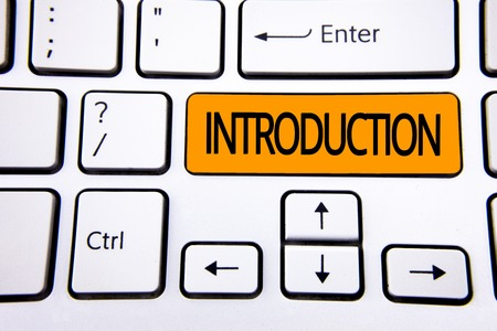 Text sign showing Introduction. Conceptual photo First part of a document Formal presentation to an audience written Orange Key Button White Keyboard with copy space. Top view.