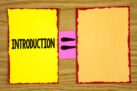 Conceptual hand writing showing Introduction. Business photo text First part of a document Formal presentation to an audience written Sticky Note Paper wooden background Equation Space. Stockfoto