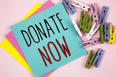 Conceptual hand writing showing Donate Now. Business photo showcasing Give something to charity Be an organ donor Help others