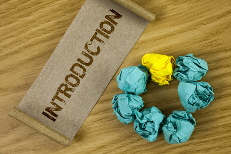 Conceptual hand writing showing Introduction. Business photo showcasing First part of a document Formal presentation to an audience written Cardboard Paper piece wooden background Paper Ball Stockfoto