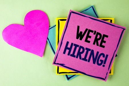 Writing note showing  We Are Hiring Motivational Call. Business photo showcasing Workforce Wanted New Employees Recruitment written Pink Sticky Note Paper plain background Heart next to it.