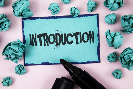 Word writing text Introduction. Business concept for First part of a document Formal presentation to an audience written Sticky Note paper plain Pink background Paper Balls and Marker. Stockfoto