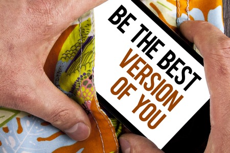Writing note showing  Be The Best Version Of You. Business photo showcasing Be Inspired to Get Yourself Better and Motivated written Mobile Screen holding by man the printed background.