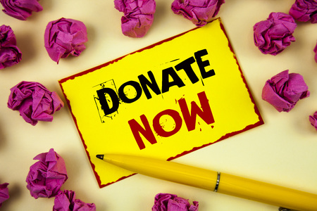Conceptual hand writing showing Donate Now. Business photo text Give something to charity Be an organ donor Help others