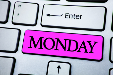 Text sign showing Monday. Conceptual photo First day of the week Back to work Weekend is over Wakeup Early written Pink Key Button White Keyboard with copy space. Top view.