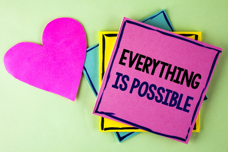 Writing note showing  Everything Is Possible. Business photo showcasing All you think or dream can become true Optimistic written Pink Sticky Note Paper plain background Heart next to it.