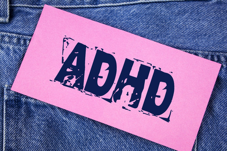 Handwriting text Adhd. Concept meaning Learning made easier for children teaching no more a difficult task written Sticky Note Paper the Jeans background.