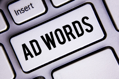 Text sign showing Ad Words. Conceptual photo Advertising a business over first of internet search results written White Keyboard Key with copy space. Top view.