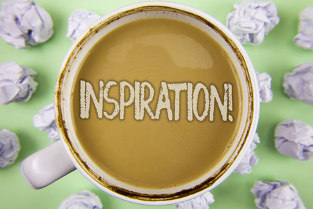 Handwriting text Inspiration Motivational Call. Concept meaning Stimulation to feel or do something creative written Tea in white Cup within Crumpled Paper Balls plain Green background.