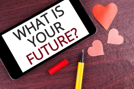Writing note showing  What Is Your Future Question. Business photo showcasing Where do you see yourself in the next years written Mobile Phone Screen wooden background Pen and Hearts Foto de archivo