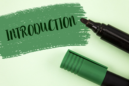 Text sign showing Introduction. Conceptual photo First part of a document Formal presentation to an audience written Painted Green background Markers next to it.