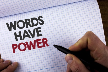 Writing note showing Words Have Power. Business photo showcasing Statements you say have the capacity to change your reality written by Man on Notebook Book holding Marker on wooden background 写真素材