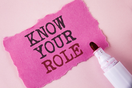 Word writing text Know Your Role. Business concept for define position in work or life Career Life goals active written Tear Pink Sticky note paper Pink background Marker next to it.