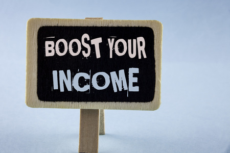 Conceptual hand writing showing Boost Your Income. Business photo showcasing improve your payment Freelancing Part time job Improve written Wooden Notice Board plain background.
