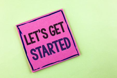 Text sign showing Lets Get Started. Conceptual photo beginning time motivational quote Inspiration encourage written Pink Sticky Note Paper the plain background.