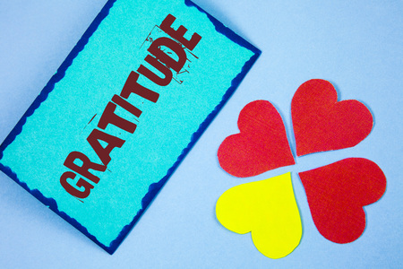 Text sign showing Gratitude. Conceptual photo Quality of being thankful Appreciation Thankfulness Acknowledge written Sticky Note paper plain background Paper Love Hearts next to it.