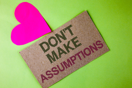 Conceptual hand writing showing Do not Make Assumptions. Business photo text predict events future without clue Alternative Facts written Cardboard Piece the plain background Heart next to it