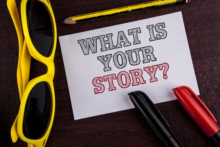 Writing note showing  What Is Your Story Question. Business photo showcasing Telling personal past experiences Storytelling written Sticky Note Paper wooden background Pen Pencil Glasses