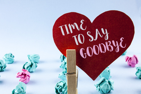 Handwriting text Time To Say Goodbye. Concept meaning Separation Moment Leaving Breakup Farewell Wishes Ending written Red Paper Heart holding by Clip plain background Paper Balls next to it. Imagens