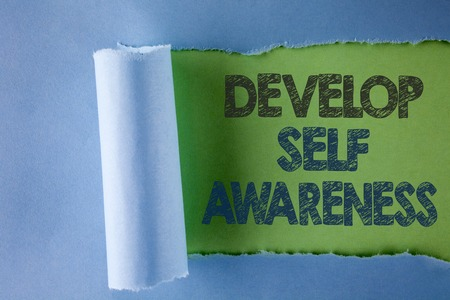 Conceptual hand writing showing Develop Self Awareness. Business photo text improve your Informations about surrounding events written under Tear Folded paper plain Green background.