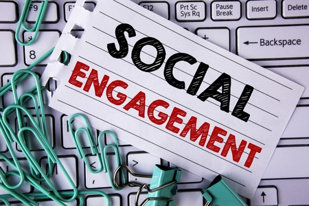 Writing note showing  Social Engagement. Business photo showcasing post gets high reach Likes Ads SEO Advertising Marketing written Tear Notepad paper placed Keyboard Clips and Paper Pins. Archivio Fotografico