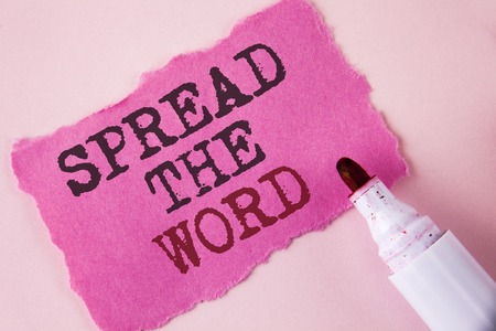 Word writing text Spread The Word. Business concept for Run advertisements to increase store sales many fold written Tear Pink Sticky note paper Pink background Marker next to it.