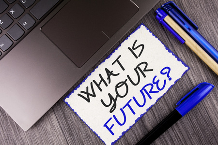 Word writing text What Is Your Future Question. Business concept for Where do you see yourself in the next years written White Sticky Note Paper the wooden background Laptop Markers Foto de archivo