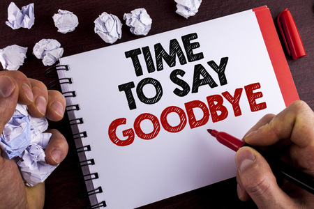 Conceptual hand writing showing Time To Say Goodbye. Business photo text Separation Moment Leaving Breakup Farewell Wishes Ending written by Man Notepad wooden background Marker Paper Balls