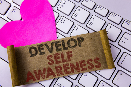 Writing note showing  Develop Self Awareness. Business photo showcasing improve your Informations about surrounding events written Folded Cardboard Paper Piece placed white Keyboard Heart.