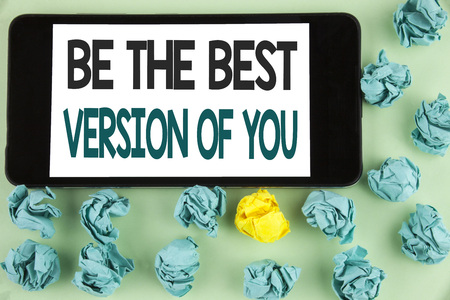 Conceptual hand writing showing Be The Best Version Of You. Business photo text Be Inspired to Get Yourself Better and Motivated written Mobile Phone Screen the plain background Paper Balls. Фото со стока