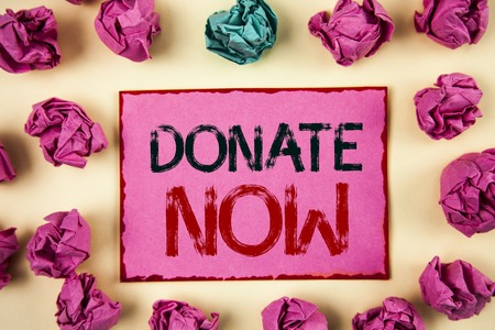 Writing note showing  Donate Now. Business photo showcasing Give something to charity Be an organ donor Help others
