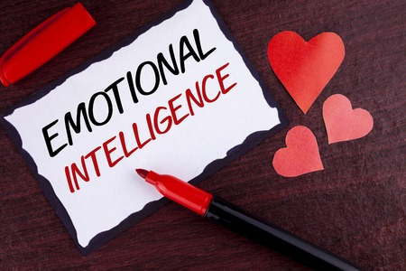 Conceptual hand writing showing Emotional Intelligence. Business photo text Capacity to control and be aware of personal emotions written Sticky Note Paper wooden background Marker and Hearts Reklamní fotografie