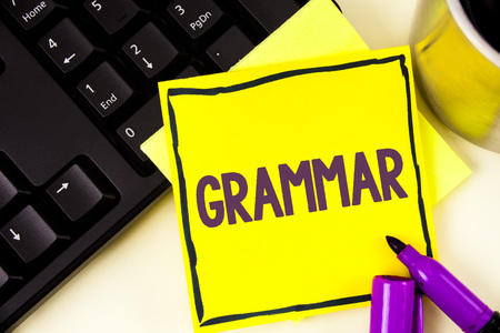 Handwriting text Grammar. Concept meaning System and Structure of a Language Correct Proper Writing Rules written Sticky Note paper plain background Cup Marker and Keyboard next to it. Stock Photo