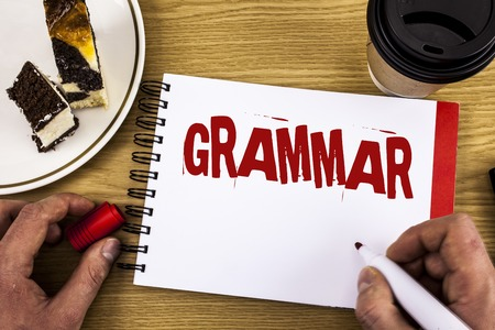 Conceptual hand writing showing Grammar. Business photo showcasing System and Structure of a Language Correct Proper Writing Rules written by Man Notebook wooden background Cake and Cup.