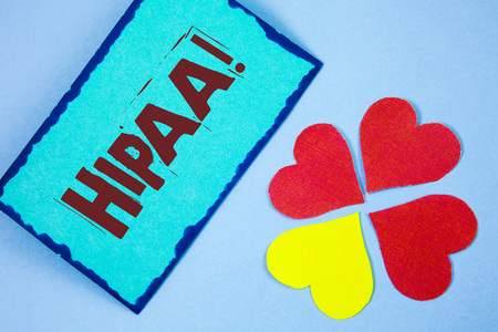 Text sign showing Hipaa Motivational Call. Conceptual photo Health Insurance Portability and Accountability Act written Sticky Note paper plain background Paper Love Hearts next to it.