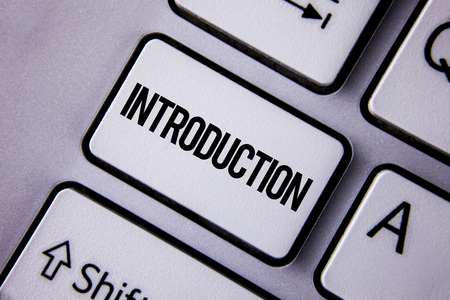 Handwriting text Introduction. Concept meaning First part of a document Formal presentation to an audience written the White Keyboard Key with copy space. Top view. Stockfoto