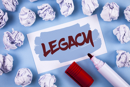 Handwriting text Legacy. Concept meaning Transmitted Received from an ancestor Money Properties given by will written Painted Sticky Note Paper within paper balls plain background Marker.