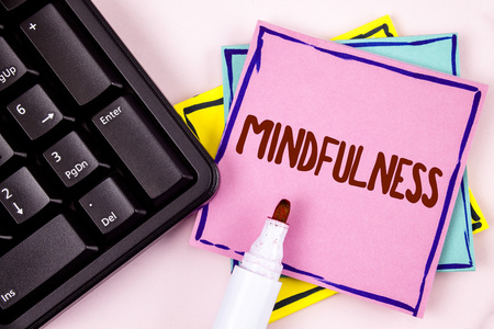 Text sign showing Mindfulness. Conceptual photo Being Conscious Awareness Calm Accept thoughts and feelings written Pink Sticky Note paper plain background Marker and Black Keyboard. Stock Photo