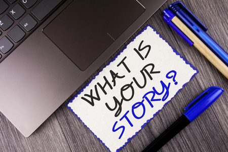 Word writing text What Is Your Story Question. Business concept for Telling personal past experiences Storytelling written White Sticky Note Paper the wooden background Laptop Markers