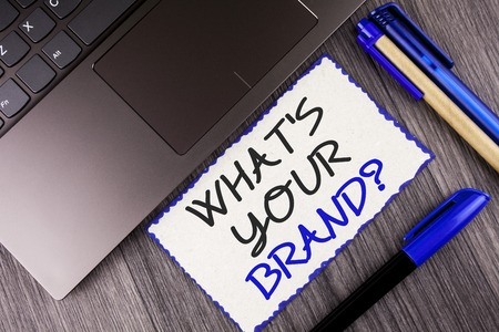 Word writing text What Is Your Brand Question. Business concept for Define Individual trademark Identify Company written White Sticky Note Paper the wooden background Laptop Markers Stock Photo