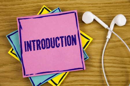 Conceptual hand writing showing Introduction. Business photo showcasing First part of a document Formal presentation to an audience written Sticky Note Paper wooden background Handsfree.