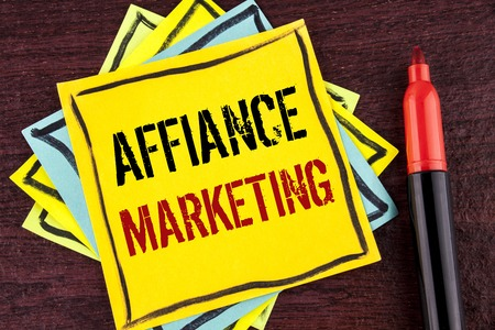 Handwriting text Affiance Marketing. Concept meaning joining two or more companies in same field mutual goal written Yellow Sticky note paper wooden background Marker next to it.