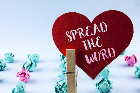 Handwriting text Spread The Word. Concept meaning Run advertisements to increase store sales many fold written Red Paper Heart holding by Clip plain background Paper Balls next to it.