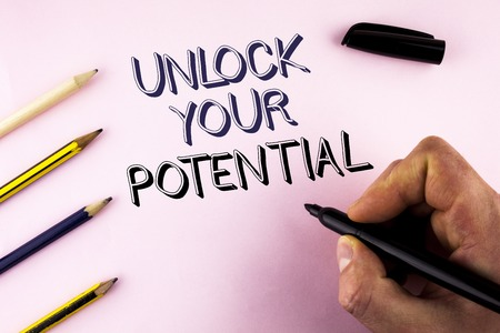 Word writing text Unlock Your Potential. Business concept for Reveal talent Develop abilities Show personal skills written by Man plain background holding Marker Pencils next to it. Stock Photo