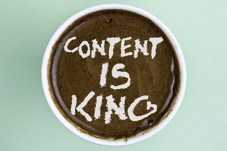 Writing note showing  Content Is King. Business photo showcasing articles or posts can guarantee you success Advertising written Coffee in a Cup the plain background. Stock Photo