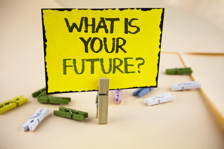 Writing note showing  What Is Your Future Question. Business photo showcasing Where do you see yourself in the next years written Yellow Sticky Note Paper on plain background Wooden Clips.